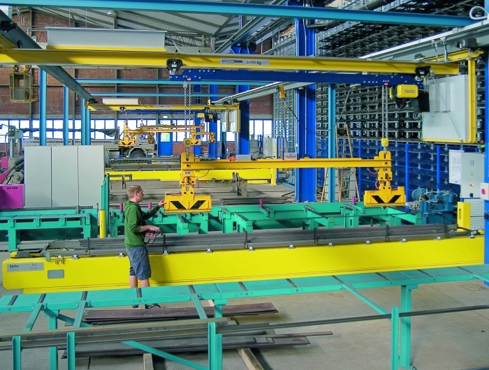 Multiple under-running GIS cranes in factory assembly line